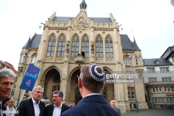 Thuringia's State Premier Bodo Ramelow wears a kippa during a rally titled Thuringia wears kippa in Erfurt central Germany on April 25 2018 Germans...