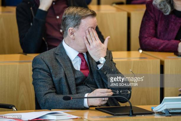 Thuringia's State Premier of the leftwing Die Linke party Bodo Ramelow reacts during the elections of Thuringia's Prime Minister on February 5 in the...