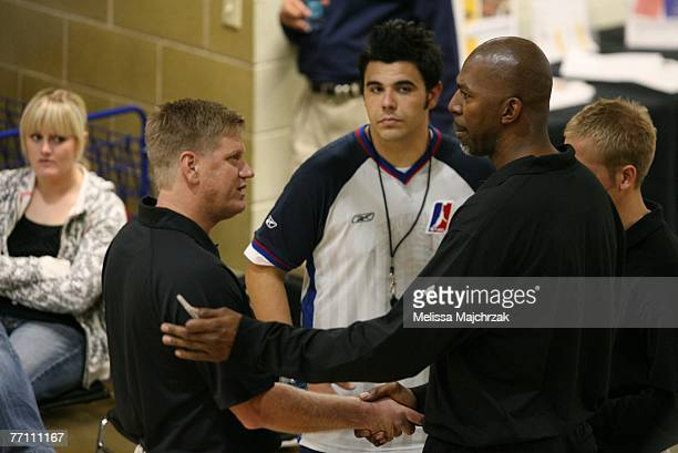 Thurl Bailey former Utah Jazz player and Head Coach Brad Jones of the Utah Flash talk during the try outs for the Utah Flash DLeague team on...