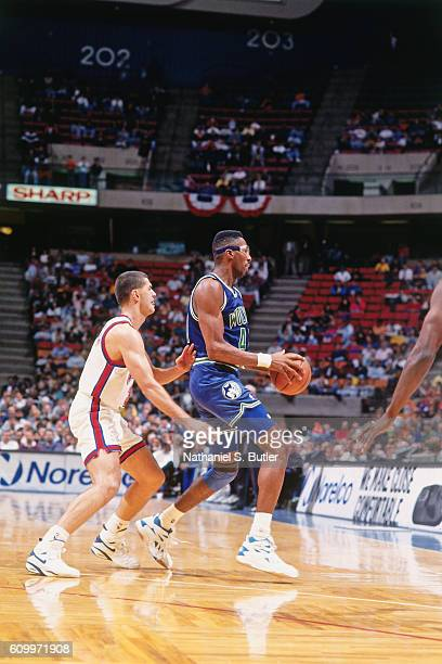 Thurl Bailey of the Minnesota Timberwolves dribbles against Drazen Petrovic of the New Jersey Nets during a game played circa 1993 at the Brendan...