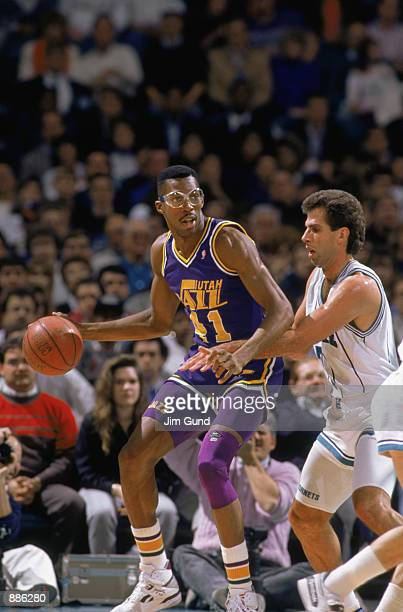 Thurl Bailey of the Utah Jazz dribbles the ball in the post during an NBA game at The Salt Palace in Salt Lake City Utah in 1989