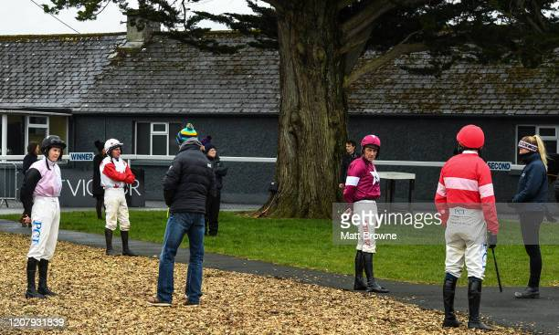 Thurles Ireland 21 March 2020 Jockeys from left Rachael Blackmore Phillip Enright Davy Russell and Paul Townend maintain social distancing in the...