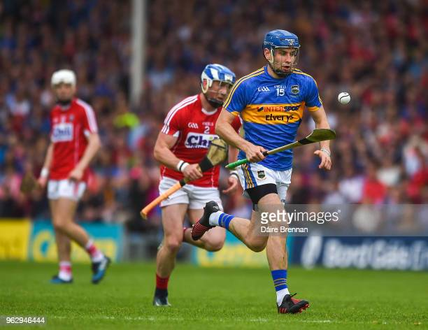 Thurles Ireland 27 May 2018 John McGrath of Tipperary in action against Seán O'Donoghue of Cork during the Munster GAA Hurling Senior Championship...