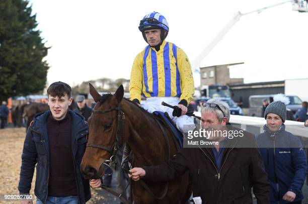 Thurles Ireland 8 March 2018 Ruby Walsh with the winning connections of Lareena after winning the thurlesie Maiden Hurdle at Thurles Racecourse in...