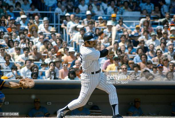 Thurman Munson of the New York Yankees bats against the Milwaukee Brewers during an Major League Baseball game circa 1975 at Yankee Stadium in the...