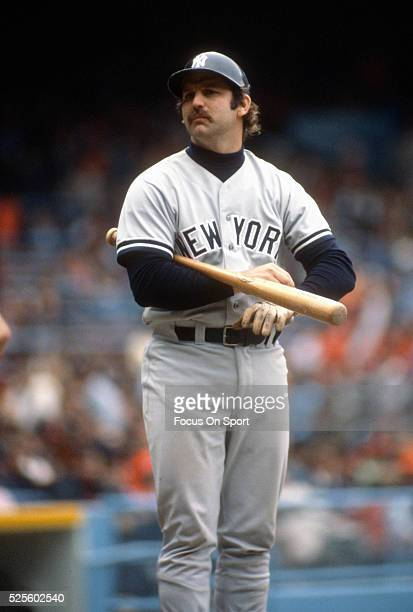 Thurman Munson of the New York Yankees looks on while adjusting his batting glove during an Major League Baseball game circa 1975. Munson played for...