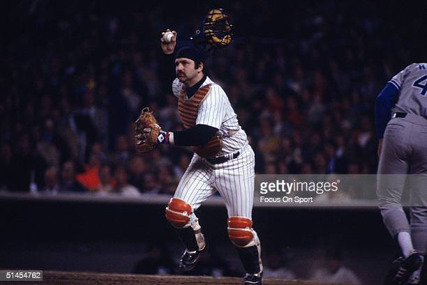 Thurman Munson of the New York Yankees throws to first during the World Series against the Los Angeles Dodgers at Yankee Stadium in Brox, NY on...