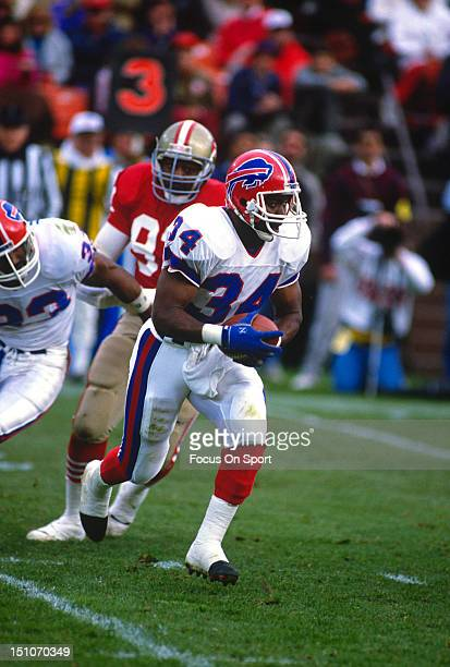 Thurman Thomas of the Buffalo Bills carries the ball against the San Francisco 49ers during an NFL football game December 17 1989 at Candlestick Park...