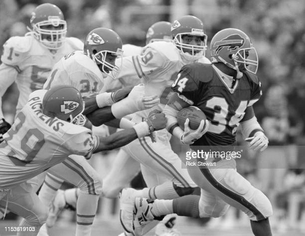 Thurman Thomas, Running Back for the Buffalo Bills runs the ball past the Kansas City Chiefs defense during their American Football Conference...