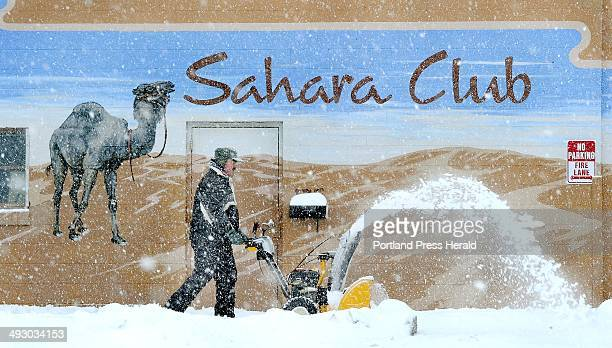 Thurs March 2012 Robert Haney of Portland snowblows dunes of snow in front of the Sahara Club along Washington Ave as southern Maine received its...