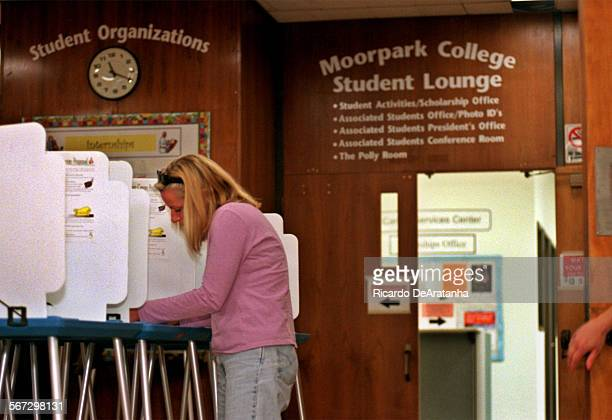 Thursday, 3/23/2000 –– Nicole Trevil of Westlake Village, casting her vote on a proposition to approve a fee hike to pay for a new student center at...