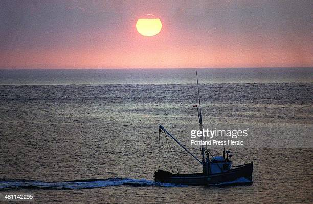 EWING Thursday August 22 1996 A fishing boat heads out to sea at dawn from Lubec Maine