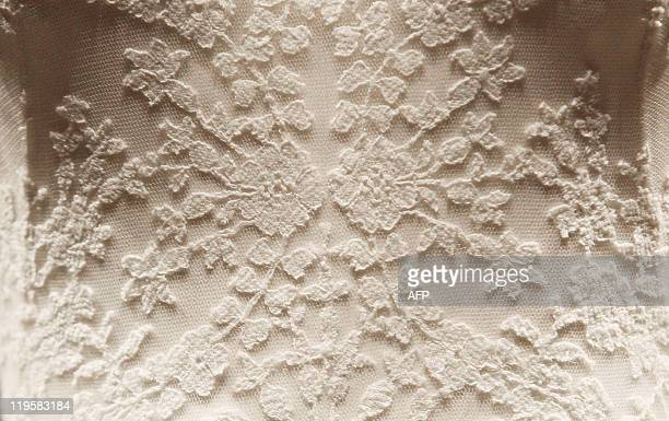 Thursday July 21 2011 at 2301 GMT THIS The wedding dress of Catherine the Duchess of Cambridge is pictured at Buckingham Palace in central London on...