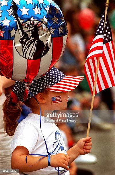 Thursday, July 4, 1996 -- Abigail Gray, 4 1/2, from Woolwich is well supplied with stars and stripes as she watches the 4th of July parade in Bath.