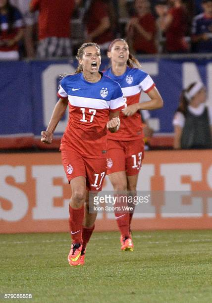 USA midfielder Tobin Heath leads the cheers as she runs back upfield after USA forward Alex Morgan in the back scored a goal during the second half...