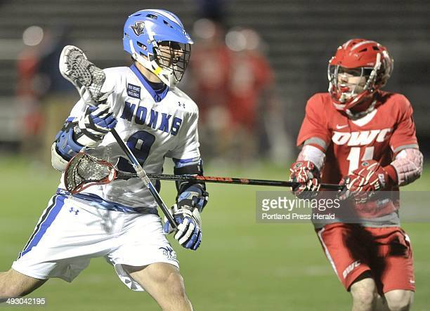 Thursday March 29 2012 St Joseph College vs Daniel Webster College mens lacrosse game played at Deering HIgh School St Joe's Paul Dolewa carries the...