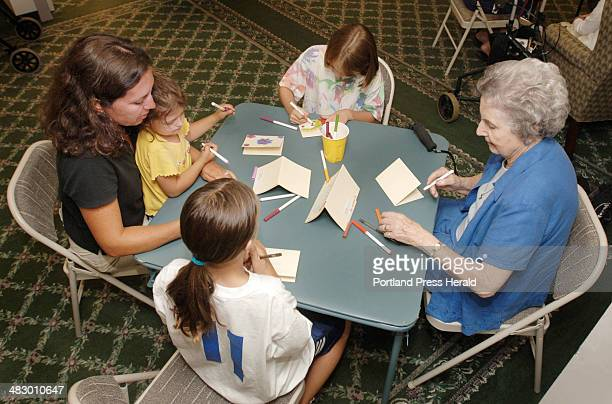 From right clockwise Adele Robinson a resident of Falmouth House at Ocean View Natalie Kuhn her mother Amy and sister Maria and Jayde Bazinet...