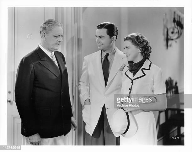 Thurston Hall getting smiles from Robert Young and Betty Furness in a scene from the film 'The Three Wise Guys', 1936.
