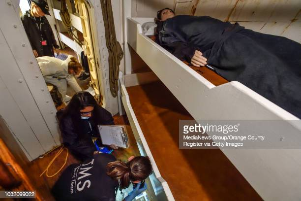 Thurston Middle School forensic students investigate the murder of a person laying in a bunk inside the Pilgrim tall ship during the investigation of...