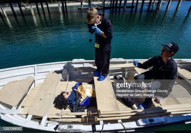 Thurston Middle School forensic students Jackson Rowley photographs evidence in a fictional murder in Dana Point on Monday Mar 19 2018 The students...