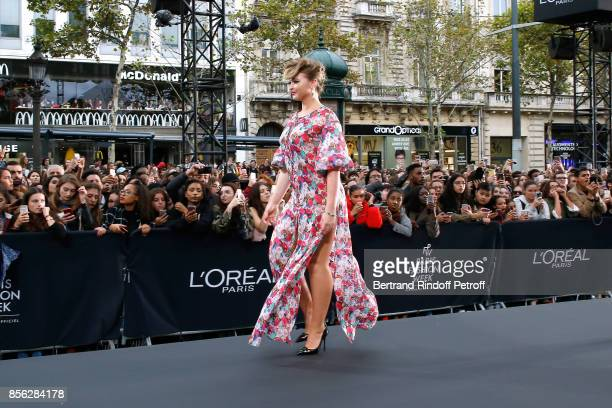Thylane Blondeau walks the runway during 'Le Defile L'Oreal Paris show' as part of the Paris Fashion Week Womenswear Spring/Summer 2018 on October 1...