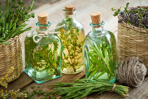 Thyme and rosemary essential oil or infusion 614864222
