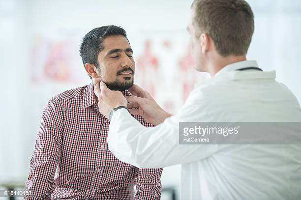thyroid examination - thyroid gland stock pictures, royalty-free photos & images