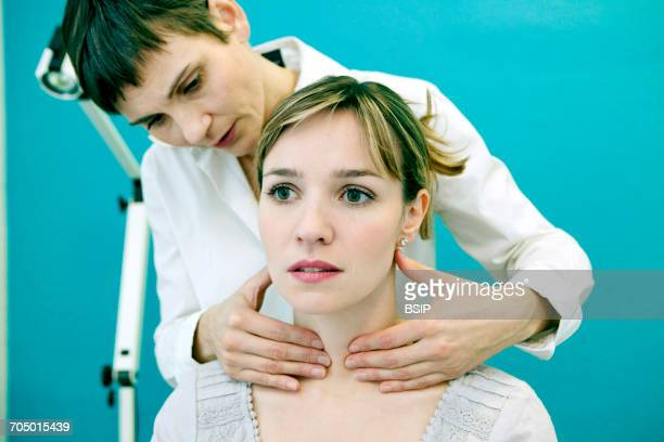 thyroid palpation, woman - thyroid gland stock pictures, royalty-free photos & images