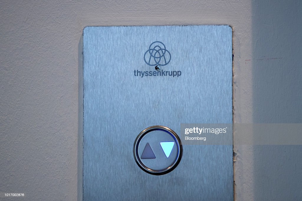 A Thyssenkrupp Elevator AG logo sits on a directional