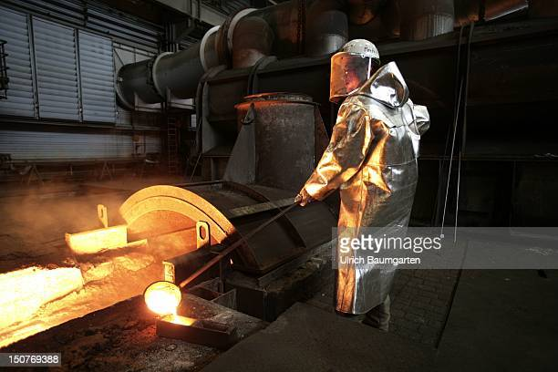 GERMANY DUISBURG ThyssenKrupp steel mill Our picture shows Workers during the casting of a steel sample