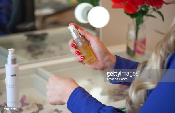 Tia Barr applies Ford MD's Retinol Multi Vitamin Serum at The Artists Project Give Back Day on February 28 2018 in Los Angeles California