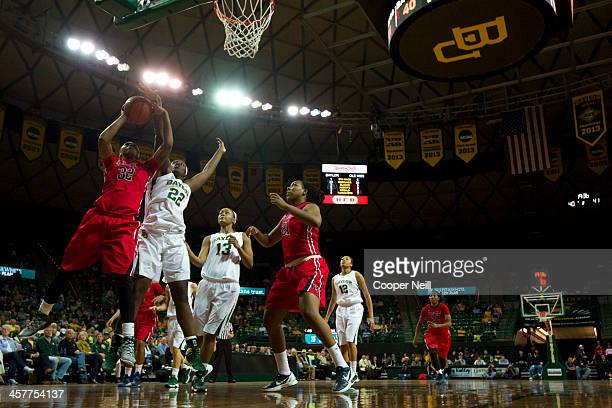 Tia Faleru of the Mississippi Lady Rebels has her shot blocked by Sune Agbuke the Baylor Bears on December 18 2013 at the Ferrell Center in Waco Texas