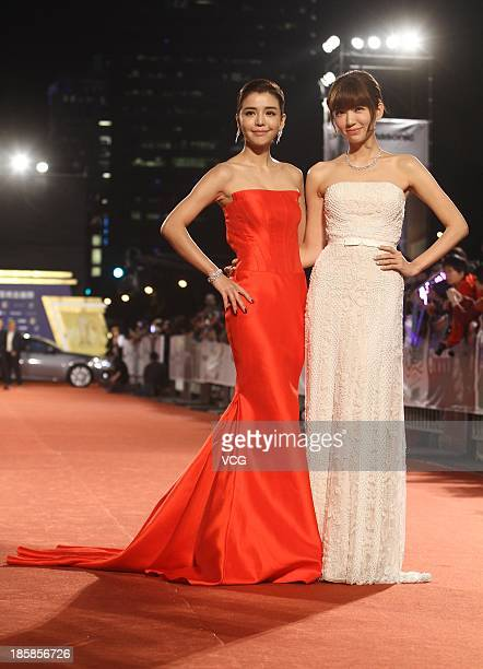 Tia Lee and Puff Kuo attend the red carpet of the 48th Golden Bell Award on October 25 2013 in Taipei Taiwan of China