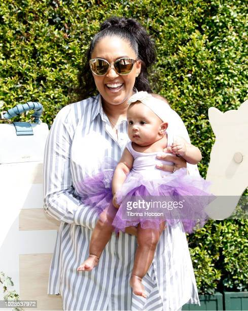 Tia Mowry and her daughter Cree Taylor Hardrict attend a BackToSchool block party at The Park at The Grove on August 25 2018 in Los Angeles California