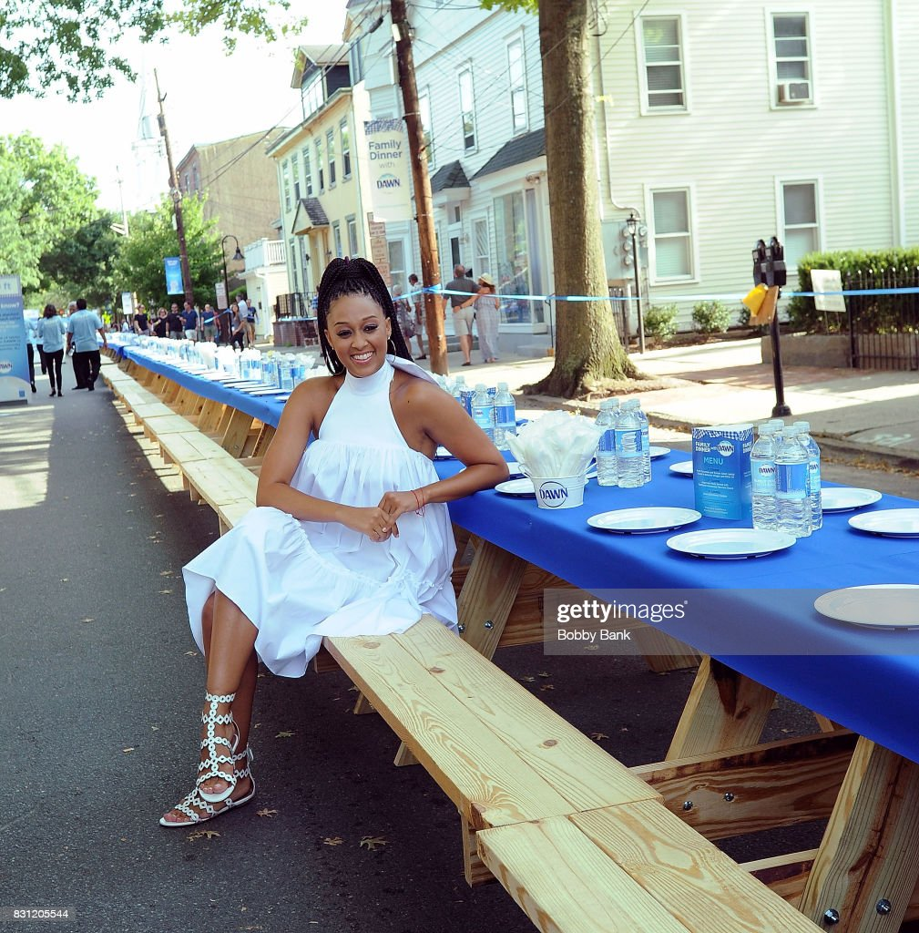 Tia Mowry hosts 'Family Dinner with Dawn' inviting the town of Lambertville to dinner taking care of the nearly 6,000 dishes with one bottle of Dawn at City Hall on August 13, 2017 in Lambertville, New Jersey.