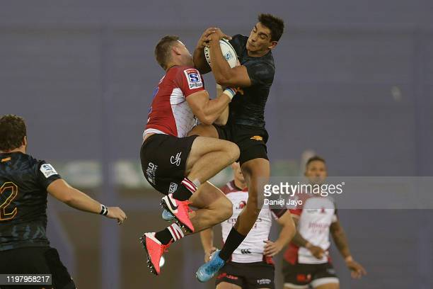 Tiaan Swanepoel of Lions and Matias Moroni of Jaguares jump for the ball during a match between Jaguares and Lions as part of Super Rugby 2020 at...
