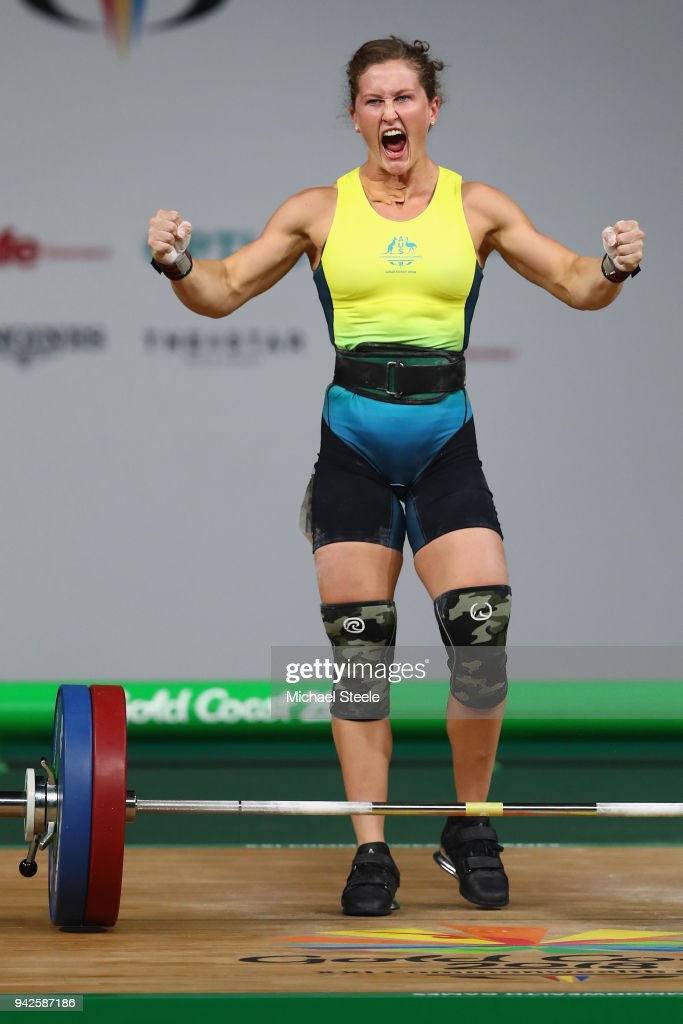 Tia-Clair Toomey of Australia celebrates a successful lift in the clean and jerk during the Women's Weightlifting 58kg on day two of the Gold Coast 2018 Commonwealth Games at Carrara Sports and Leisure Centre on April 6, 2018 on the Gold Coast, Australia.