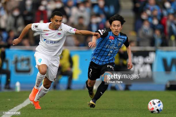 Tiago Alves of Sagan Tosu and Kyohei Noborizato of Kawasaki Frontale compete for the ball during the JLeague MEIJI YASUDA J1 match between Kawasaki...