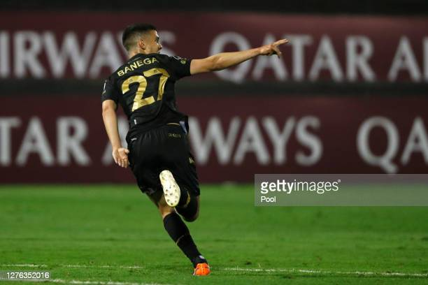Tiago Banega of Racing Club celebrates after scoring the opening goal during a Group F match between Alianza Lima and Racing Club as part of Copa...