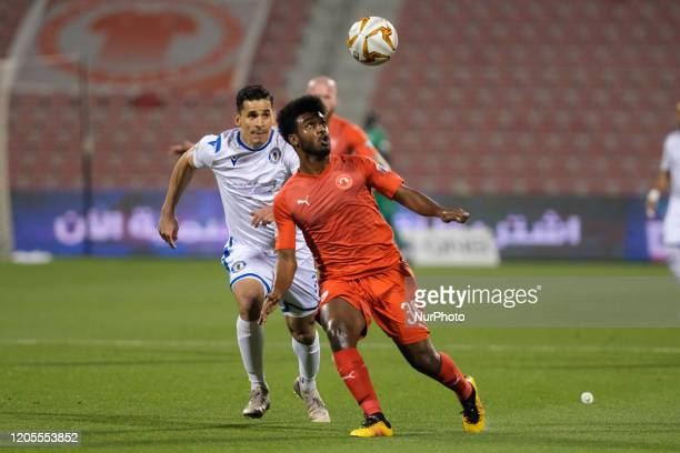Tiago Bezerra of Al Khor and Mohamed Hamadato of Al Arabi compete for the ball during the QNB Stars League at the Grand Hamad stadium on March 6 2020...