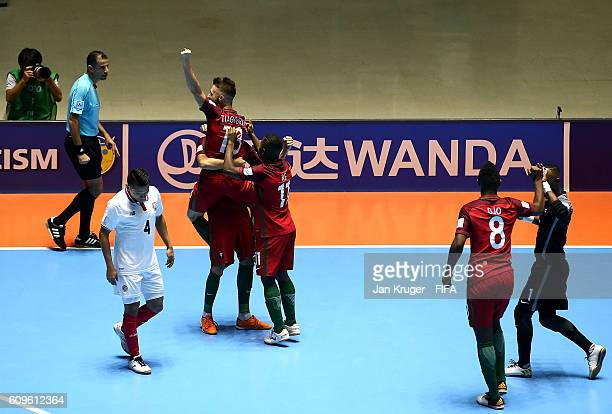 Tiago Brito of Portugal celebrates his goal with team mates during the FIFA Futsal World Cup round of 16 match between Portugal and Costa Rica at...