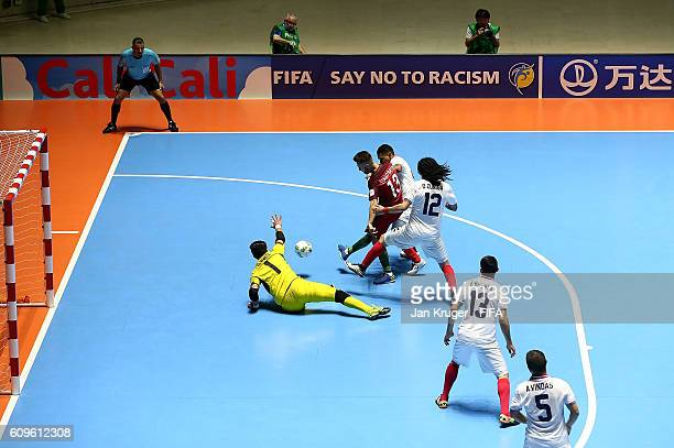 Tiago Brito of Portugal scores his goal during the FIFA Futsal World Cup round of 16 match between Portugal and Costa Rica at Coliseo el Pueblo on...