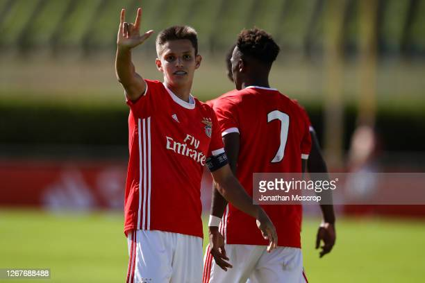 Tiago Dantas of Benfica celebrates with team mate Umaro Embalo after scoring a second half penalty to give the side a 3-0 lead during the UEFA Youth...
