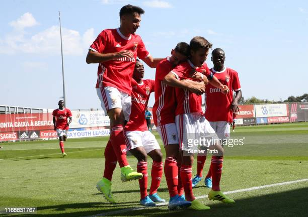 Tiago Dantas of SL Benfica celebrates with teammates after scoring a goal during the UEFA Youth League Group G match between SL Benfica and RB...