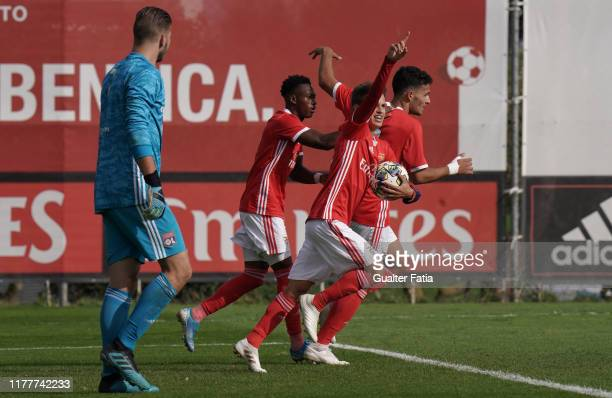 Tiago Dantas of SL Benfica celebrates with teammates after scoring a goal during the UEFA Youth League Group G match between SL Benfica and Olympique...