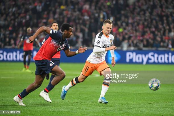 Tiago DJALO of Lille and Denis CHERYSHEV of Valencia during the UEFA Champions League Group H match between Lille and Valencia on October 23 2019 in...