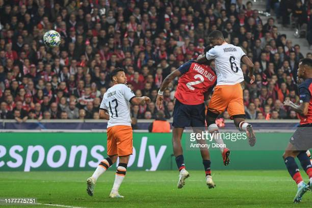 Tiago DJALO of Lille and Geoffrey KONDOGBIA of Valencia during the UEFA Champions League Group H match between Lille and Valencia on October 23 2019...