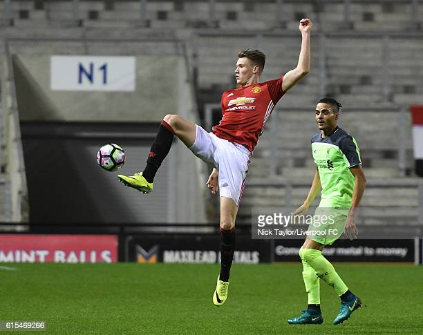 Tiago Ilori of Liverpool and Scott McTominay of Manchester United in action during the Premier League 2 match between Manchester United and Liverpool...