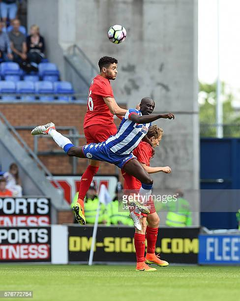Tiago Ilori of Liverpool goes up with Sanmi Odelusi of Wigan Athlitic during the PreSeason Friendly match between Wigan Athletic and Liverpool at JJB...