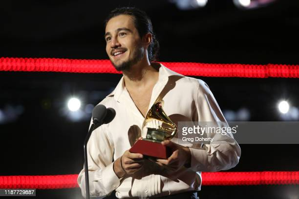 Tiago Iorc accepts the award for Best Portugeuse Language Song onstage at the Premiere Ceremony during the 20th annual Latin GRAMMY Awards at MGM...